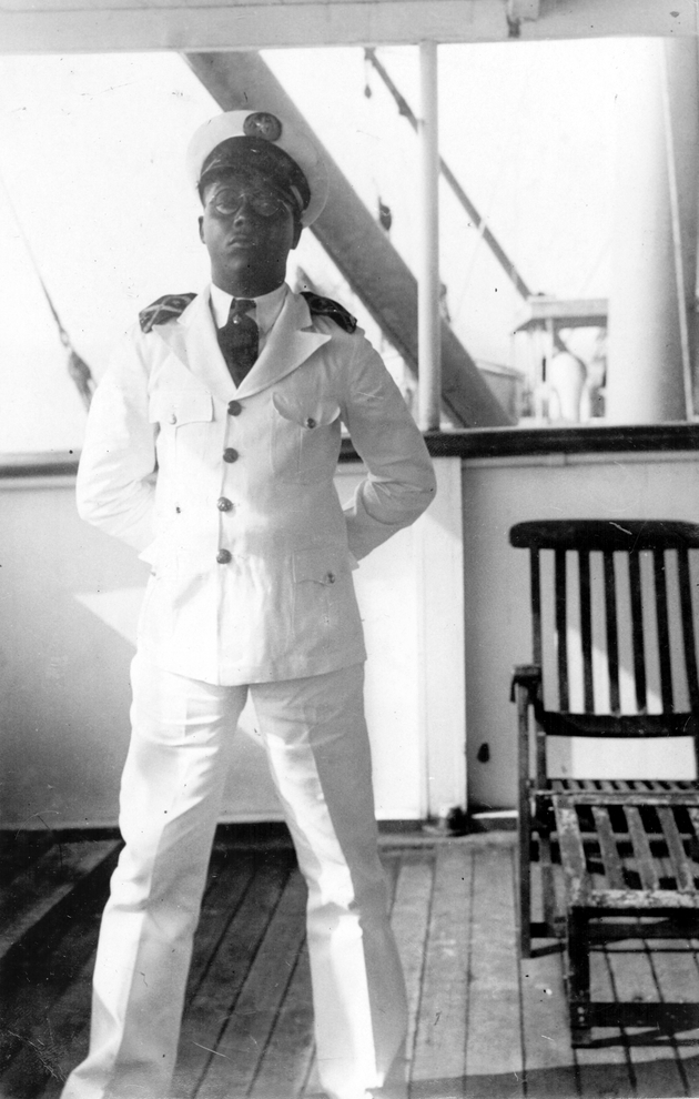 An African crewman poses in dress whites on board the S.S. Cathlamet.