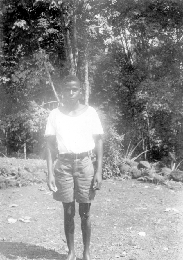 Photo: Liberian man in khaki shorts and white t-shirt posing.