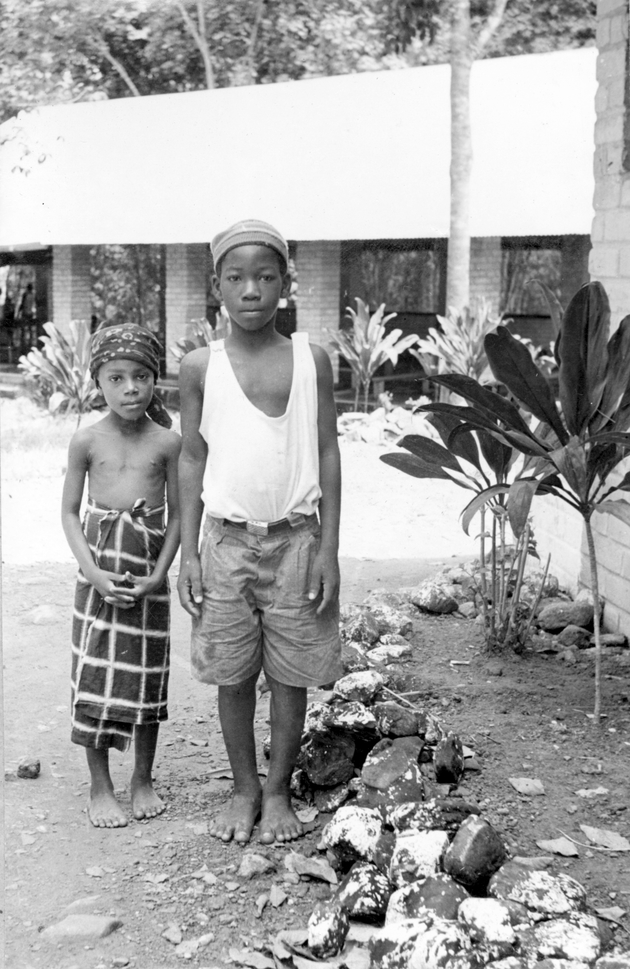 Photo: Two Liberian children, one in Western and another in local dress.