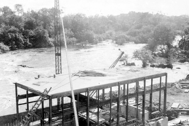 Photo: Construction project on bank of large river.