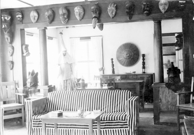 Photo: Manis residence interior with 19+ masks, Deangle costume for masquerade (now in Harn collections).