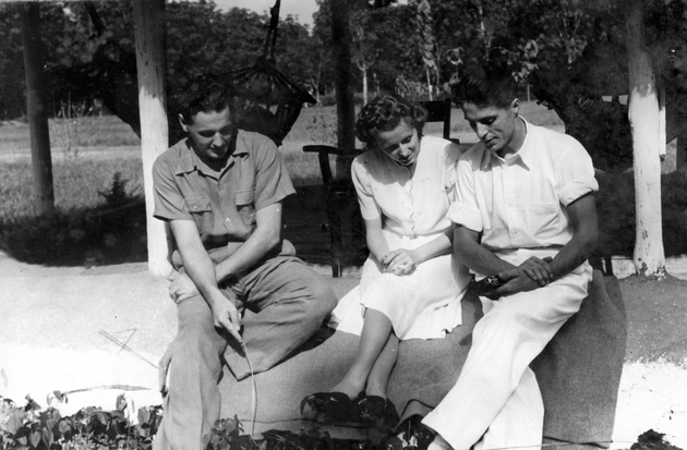 Photo: Two American men and a woman, seated. Manis is on the right.