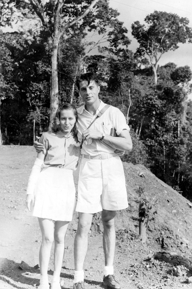 Photo: An American man (Manis) and woman, standing at top of a steep hill.