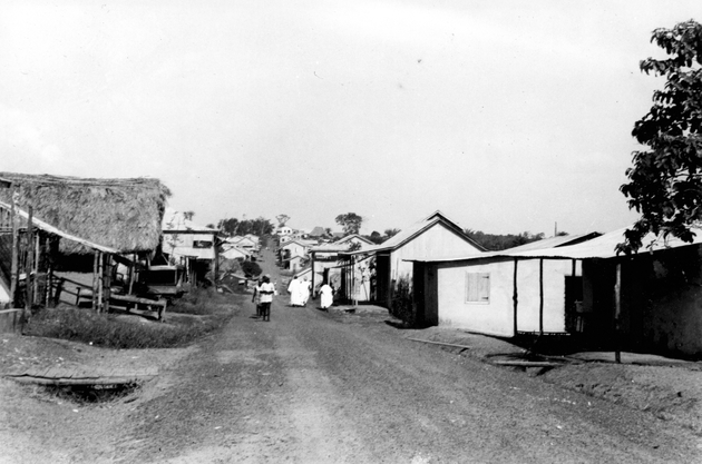 Photo: Street scene, African urban buildings (possibly Kakata, site of the Booker Washington Institute vocational and agricultural school).