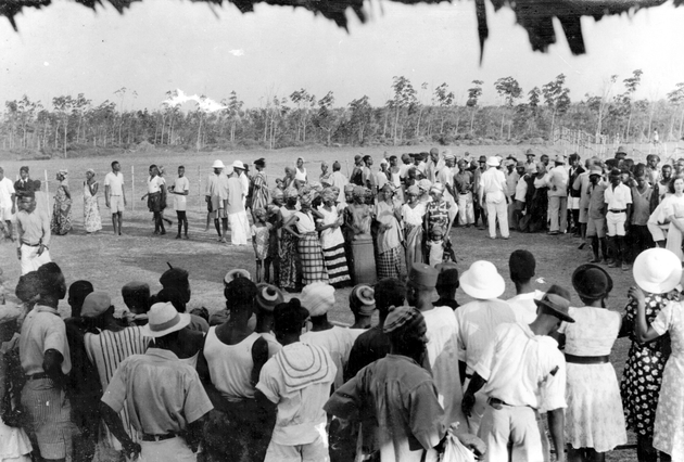 Photo: A large group of Liberians and Americans surrounds a group of Liberian women.