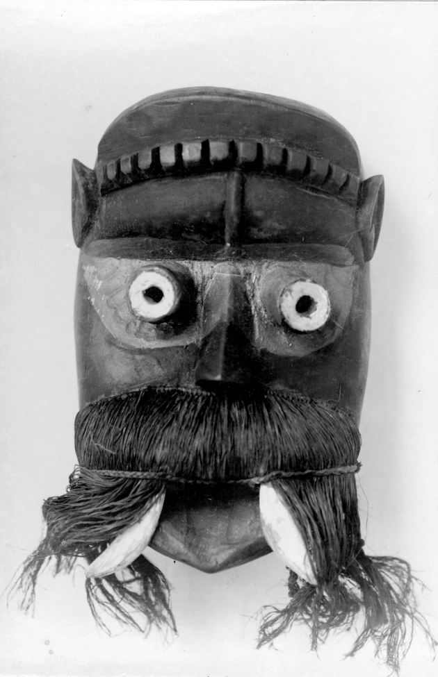 Photo: Mask 2. Mustached figure with tusks.