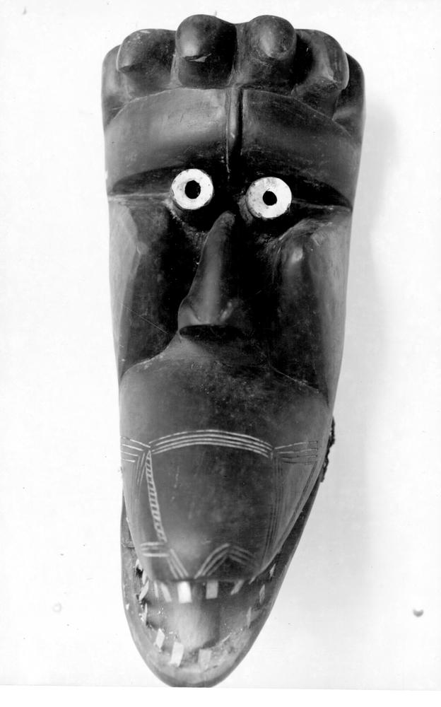 Photo: Mask 5. Figure with crocodile shaped mouth.