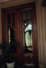 Exterior door with plant in pot