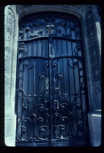 Door or window with wrought iron cover
