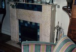 Fireplace and chair in interior room