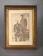1 photo of Jose Marti and another person, framed.