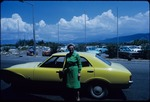 Eleanor Friend Sleight in front of a Ford Cortina rental car in Kingston, Jamaica