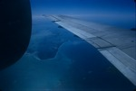 An airplane wing and aerial view of Jamaica