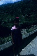 A school girl standing on the road side in Moore Town, Portland, Jamaica