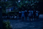 A teacher instructing students during an outdoor lesson in Port Antonio, Portland, Jamaica