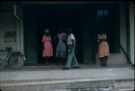 People standing outside the Central Drug Store in Ocho Rios