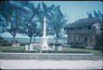 A stone cross monument near a bay in Saint Ann, Jamaica