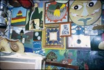 Paintings on the wall of Everald Brown's studio
