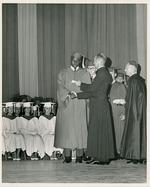 Cuban boy receiving his diploma from high school