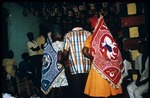 Priestesses holding voodoo flags