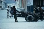 Man pulling a wheelbarrow in Downtown Port-au-Prince