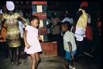 Adults and children dancing at a voodoo ceremony
