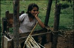 Young girl making rope