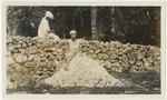 Girl crushing rocks for roads in Jamaica