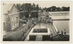 People waiting to obtain water at Cavaliers waterworks in Saint Andrew, Jamaica
