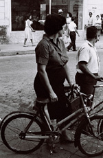 Woman with bicycle, Camaguey