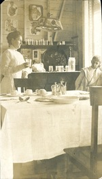 Woman and boy setting table
