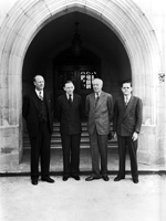 University of Florida president John J. Tigert, Walter J. Matherly and two other men by arch of a building