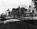 West side of University Auditorium seen from a dirt road