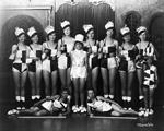 11 women in dance costumes