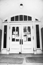 West entrance of Peabody Hall showing fliers taped to the windows.
