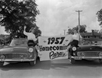 Banner at start of University of Florida Homecoming parade held by two women each in a car.