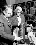 Stanley West, Director of Libraries and Lilly Carter, Acquisitions Head look at millionth volume