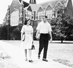 Two students walk by the east side of University Auditorium at the University of Florida