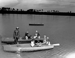 4-H members in two row boats at Camp Doe Lake.
