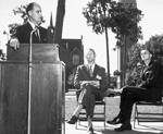 "Fred ""Bud"" Dickinson, Billy Matthews, and University of Florida President J. Wayne Reitz on temporary stage, Plaza of the Americas."