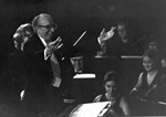 Aaron Copland conducts the University of Florida Symphony Orchestra at dedication ceremonies for the new music building