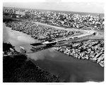 Aerial view of Puerto Rican metropolitan area fronted by poor residential areas