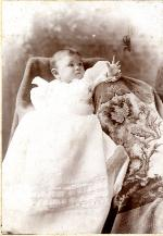 Portrait of Marjorie Kinnan Rawlings, age 9 months, reaching out with arm.