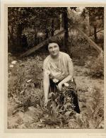 Marjorie Kinnan Rawlings kneeling in her garden at home in Cross Creek
