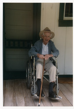 Norton Baskin at age 92 with cane, in wheelchair on front porch of the Rawlings house in Cross Creek