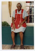 Sissy Fountain, age 83, sitting on wood box in Cross Creek