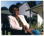 Idella Parker posing for picture in Marjorie Kinnan Rawlings' yard in Cross Creek