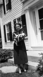 Marjorie Kinnan Rawlings at her Van Hornesville house holding Marco Polo and other cats