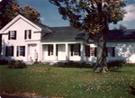 Color photograph of Marjorie Kinnan Rawlings at Van Hornesville home with pet dog Moe