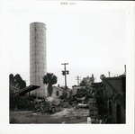 [Water tower and demolition debris on back of Block 8 Lot 3 (currently Tocques parking lot) prior to construction of Pan American Building, looking South, 1965]